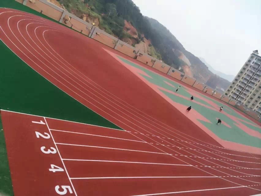 Spray coat synthetic running track permeable athletic rubber track